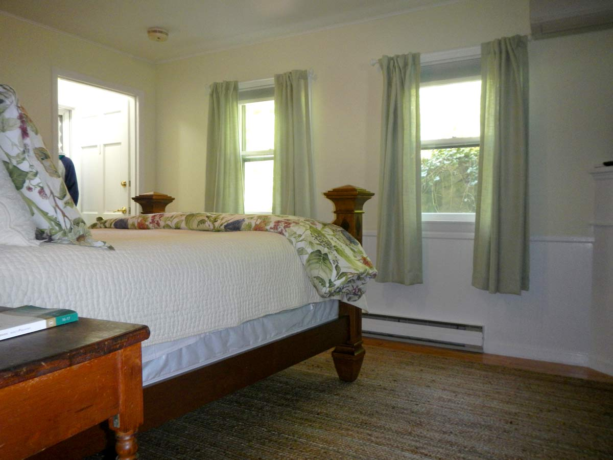 View of bed and two windows pop-up